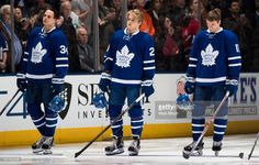 Auston Matthews #34, William Nylander #29, and Zach Hyman #11 of the Toronto Maple Leafs stand in the ice during the anthems prior to the game against the New Jersey Devils during the first period at the Air Canada Centre on March 23, 2017 in Toronto, Ontario, Canada.