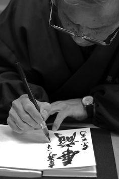 Shuin 朱印 writer at Todai-ji temple, Nara, Japan