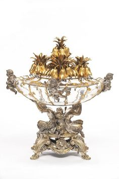Cutting table centerpiece    Designation - Overall:  mainly    Created by,  Emile Froment-Meurice goldsmith, Paris, 1867  Emile-Francois Carlier sculptor  Use / destination:  Models for which the most original, commissioned by Napoleon III in 1867 was presented to the Paris Exposition.  Materials and techniques:  glass, gilt bronze, silver.