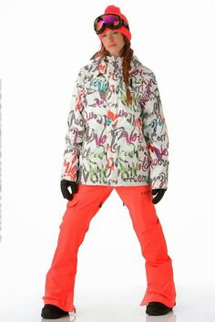 Alexandra Jean is a white VOLCOM ski jacket with handwriting words in black,  mandarin orange, mint green,  fuchsia,  & azure.