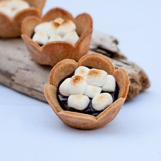 Top ganache-filled graham cracker cups with marshmallows roasted over a bonfire. Alternatively, top the cups with mini marshmallows and broil in your oven.