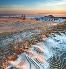 Lake Michigan sand dunes photographed from Sleeping Bear Point at daybreak by Robert de Jonge (mynorth.com) #michigan