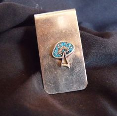 Mens Alpaca Silver Money Clip with Crushed Turquoise Inlay Design. Ornate mushroom of Inlayed Turquoise and polished Alpaca Silver accents.