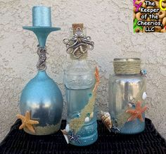 Materials: Glitter Blast Spray CLICK HERE, Dollar Store Wine Glass or bottles, Looking Glass Spray, Sand, Hemp, Glue, Shells and Starfish, other embellishments, and led candle lights. If you have never seen the mercury glass look then you will definitely want to Google it, I just love the look and wanted to put a fun spin on it. The inside of the glasses or bottles are done to look like mercury glass (if you Google mercury glass tutorials there are tons of them on the specifics of how to…