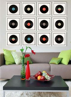 A beautiful collection of framed records make​​ a nice graphic statement on a wall. It can also bring a lot of good memories.