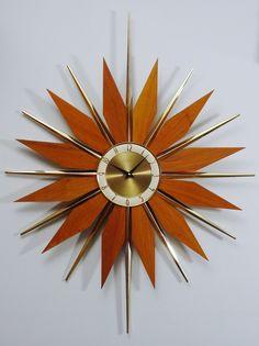 Vintage Starburst Clock, Mid-Century Modern Atomic Wall Clock, Large Sunburst Design. via Etsy.