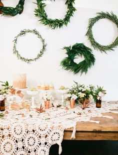 Greenery Wreaths: Have a few wreaths made with different types of greenery for an eclectic statement at your fall wedding. Pair with copper decorations to create a modern tablescape.
