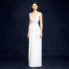 """Made from a silk and cotton twill (it has a low lustre that photographs beautifully), the simple yet stunning silhouette of this gown makes for a grand entrance, thanks to a deep V-neckline that our designers carefully curved <i>just so </i>to make it both dramatic and super-flattering. Finished with a beautifully hand-beaded empire waist, this is one you'll want to pass down as a family heirloom. <ul><li>Straight silhouette.</li><li>Falls to floor, 65"""" from high point of shoulder (based off…"""