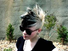 I'd never have the guts to wear this myself but I'm pinning for awesome color placement, the color itself, the faux/mohawk style, and the pixie cut. It's nearly shaved on the sides and long in top which gives this so much versatility. You can be classy and sleek or punk and rock this!