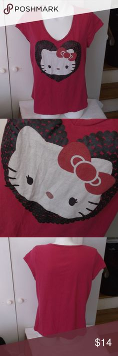 Hello Kitty Pink Cap Sleeve T Shirt XXL Junior This is a juniors t shirt by Hello Kitty Sanrio in a size XXL or 18 Juniors 100% cotton Cap sleeves, v neckline Rose pink in color with white, black and pink Hello Kitty head in heart on front In very good used condition Sanrio Tops Tees - Short Sleeve