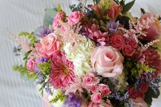 Bridal Bouquet created by Gene Rubey, owner of Gene's Floral. Beaver Dam Wisconsin. Pink roses, white hydrangea, pink spray roses, pink astilbe, yellow solidago, purple freesia, pink gerbera daisy.