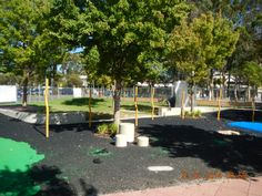 "The black underlayer of the new ""soft-fall"" rubber, with new yellow play poles. #renewal 21-01-2014"