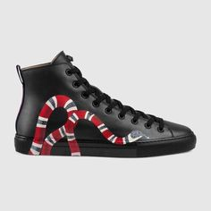 ceab860909c Shop the Leather high-top with snake by Gucci. The image of the snake has  become synonymous with the House. The coiling motif is printed along the  sides of ...