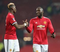 Paul Pogba and Romelu Lukaku of Manchester United celebrate after the Emirates FA Cup Third Round match between Manchester United and Derby County at...
