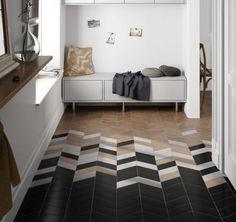 black herringbone tiles coming into wooden ones gradually