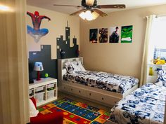 My sons' SuperHero Bedroom with cityscape handprinted on the Wall.