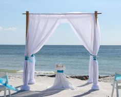 White chiffon with turquoise accents next to the surf