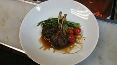 Med-rare rack,grilled asparagus and tomatos With pomegranate molasses