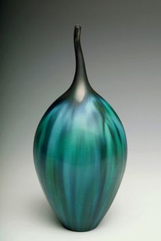 Teal Striped Bottle (Jan Bilek).  This piece is wheel-thrown and altered #porcelain. In order to create  a balance between form and surface,  the artist utilized multiple layers of flowing glazes to express a sense of movement and dimension that is organic in nature.