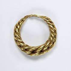 Gold ring, of plaited wire, tapering towards the back where they are beaten flat, Viking, 9th to 11th century