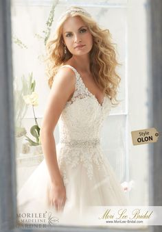 """Dress Style OLON Classic Tulle Ball Gown With Crystal Beaded, Alencon Lace Appliques And Wide Scalloped Hemline Removable Beaded Satin Belt. Available in Three Lengths: 55"""", 58"""", 61"""". Colors available: White, Ivory, Ivory/Light Gold"""
