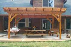 pergola with hammock. maybe put a swing on the other side?
