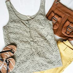 J. Crew Lace and Jersey Tank Top This gray tank is made of stretch jersey with a lacey overlay on the front. A simple scoop neck and button placket elevate this tank, making it the perfect match for a blazer and dress pants or jeans and flats. J. Crew Tops Tank Tops