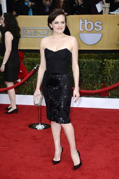 Elizabeth Moss showed a little leg in a black sequin skirt Dolce & Gabbana mini, classic black pumps, a sparkling Jimmy Choo clutch, and one-million-dollar diamond earrings. #SAGAwards