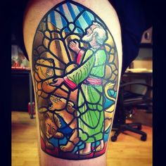 Biblical stained glass tattoo of Daniel in the Lion's Den.