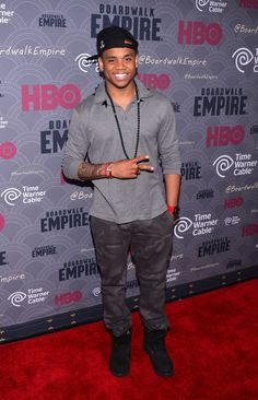 """Tristan Wilds wears Givenchy Star Patched and Striped Polo Shirt at  """"Boardwalk Empire"""" Season 4 Premiere f8ba066fe"""