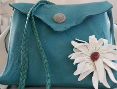 Turquoise flower power purse made from turquoise deer hide with a handmade white leather daisy and carnelian flower center