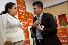 Former Washington Post journalist turned immigration reform activist, Jose Antonio Vargas, right, an illegal immigrant, is overcome with emotion speaking to Gaby Pacheco, 27, of Miami, an illegal immigrant originally from Ecuador, after watching President Obama announce that the U.S. government will stop deporting and begin granting work permits to younger illegal immigrants who came to the U.S. as children and have since led law-abiding lives, Friday, June 15, 2012, in Washington.