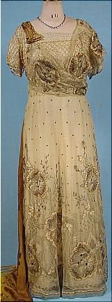 """Court gown, 1912. That's """"court"""" as in, the place where the Queen hangs out. The detail on this is fantastic. An expert described this dress as """"""""Court gown c. 1912 of heavily embroidered net with a """"manteau de cour"""" of ombre shaded crepe-damasse"""". (If you ever need to use """"crepe-damasse"""" in a sentence, there you go.)"""