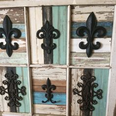 Window frame with salvaged wood and Fleur de lis