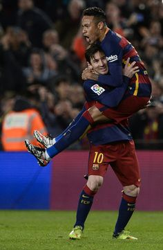 Barcelona's Argentinian forward Lionel Messi (bottom) celebrates a goal with teammate Barcelona's Brazilian forward Neymar during the Spanish league football match FC Barcelona vs Sevilla FC at the Camp Nou stadium in Barcelona on February 28, 2016.