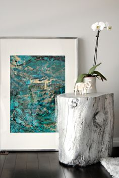 DIY Silver Leaf Stump Table with spray paint. Love the art and the elephant.