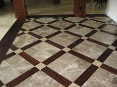 tile inlayed detail in wood floor. match the shower to the ...