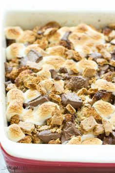 S'mores Overnight French Toast Casserole: An easy, overnight french toast casserole is topped with marshmallows, chocolate chunks and graham crackers and baked until irresistibly gooey -- the perfect breakfast, brunch or brinner to take you from summer right through back to school! Only 8 ingredients! www.thereciperebel.com