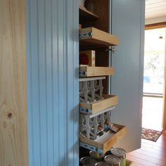 A double pantry with pull-out drawers adds lots of storage space to this country kitchen. | thisoldhouse.com/yourTOH