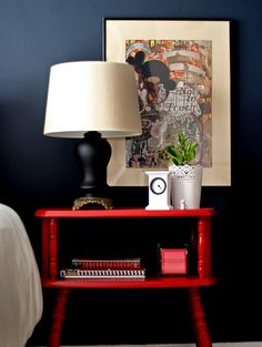 Love the idea of hanging art above a besdie table like this. Wall color - bm hale navy