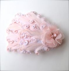 Hey, I found this really awesome Etsy listing at https://www.etsy.com/listing/181301147/champagne-pink-feather-clip-with-pearls