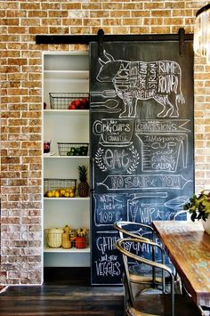 This is a great pantry for an eclectic home with brick walls and blackboard paint.