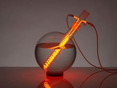 rolf sachs creates lighting objects from neon gas + glassware