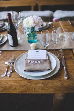 place cards with pennant bunting // photo by Jessica Oh // http://ruffledblog.com/rustic-upstate-new-york-wedding
