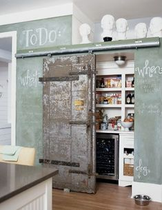 "I'm not sure how I feel about the green chalkboard paint (too schoolmarm-ish?)  but I love how the homeowner turned it into a ""to do"" list and in the lower right corner writing ""dog"" above the dog's water bowl. Fun!"