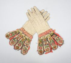 A pair of gloves with embroidered gauntlets, 17th century.