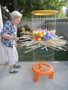 """How fun!!! Backyard Kerplunk - Just flip the cage over to reset. Used 3/8"""" x 3' square dowels instead of the bamboo plant sticks. The bamboo did not work very well. #funbackyards"""