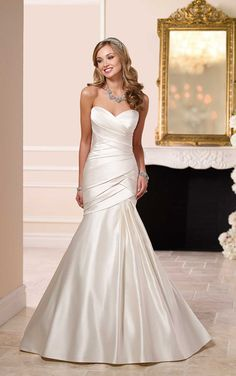 Fitted Wedding Dress from the Stella York bridal collection features a fitted bodice of thick crisscross pleating.