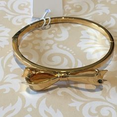 """Brand New Kate Spade Gold Bow Bracelet NWT gold bow bracelet. Diameter 2.25"""" fits writs up to 8"""". This is listing is for the gold  bracelet only. Other colors/designs also available in my closet kate spade Jewelry Bracelets"""