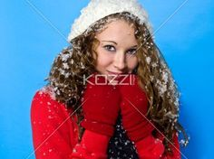 cute young woman in winter clothing. - Cute young woman in winter clothing looking at camera against turquoise background, Model: Brittany Beaudoin